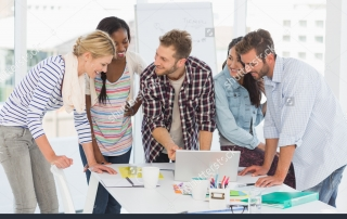 stock-photo-smiling-team-of-designers-having-a-meeting-in-creative-office-181274324